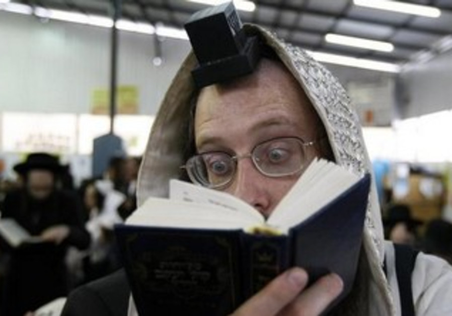 An Orthodox Jew prays in the Ukrainian town of Uman.