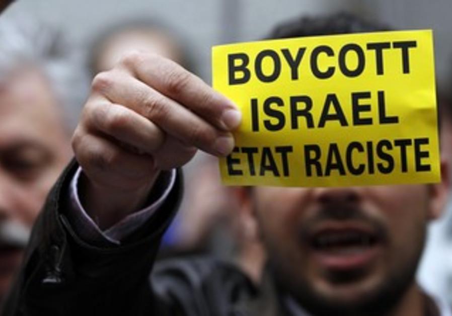 Man holds boycott Israel sign