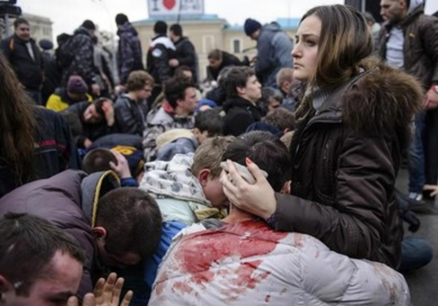 Wounded supporters of pro-government forces in Ukraine recover from riots.