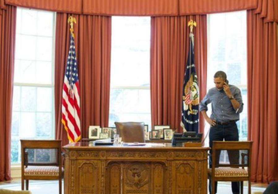 US President Barack Obama seen on the phone with Russian President Vladimir Putin discussing crisis