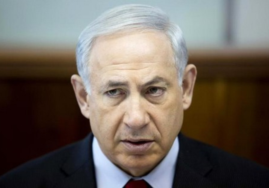 Benjamin Netanyahu attends the weekly cabinet meeting at his office in Jerusalem March 23, 2014.
