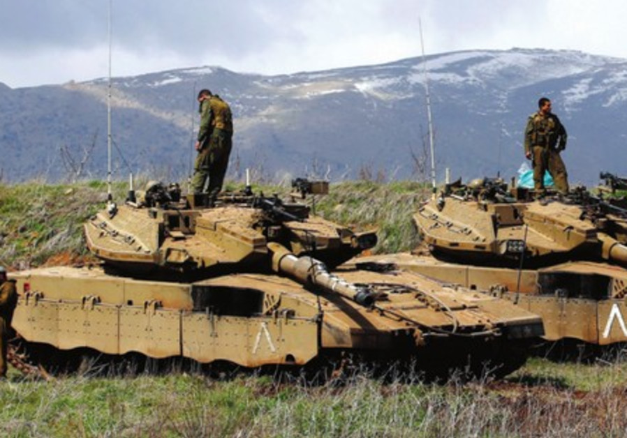 IDF tanks are deployed on Golan, March 19, after IAF hit Syria military sites in response to a bomb