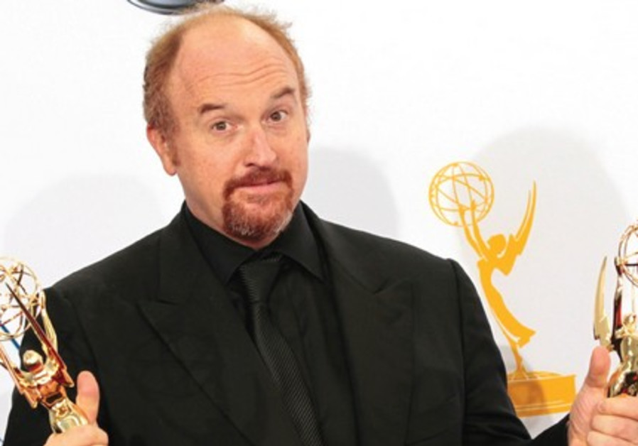 LOUIS CK holds Emmy awards for his show 'Louie' at the 64th Primetime Emmy Awards in Los Angeles in