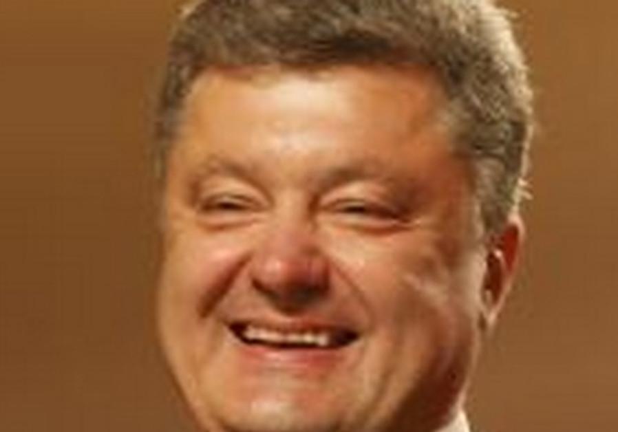 Ukrainian businessman, politician and presidential candidate Petro Poroshenko smiles as he speaks to