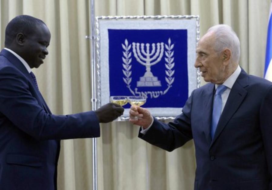 President Peres meets Uganda Ambassador Mr. Angualia Laus Richard