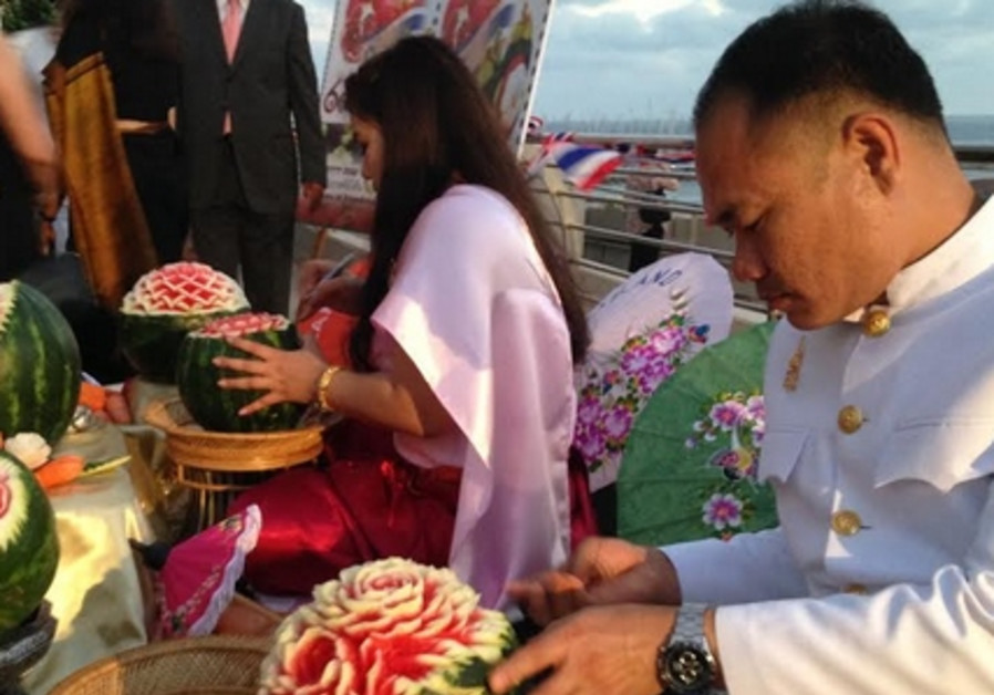 Carving fruit at Thai Embassy event, June 24, 2014.