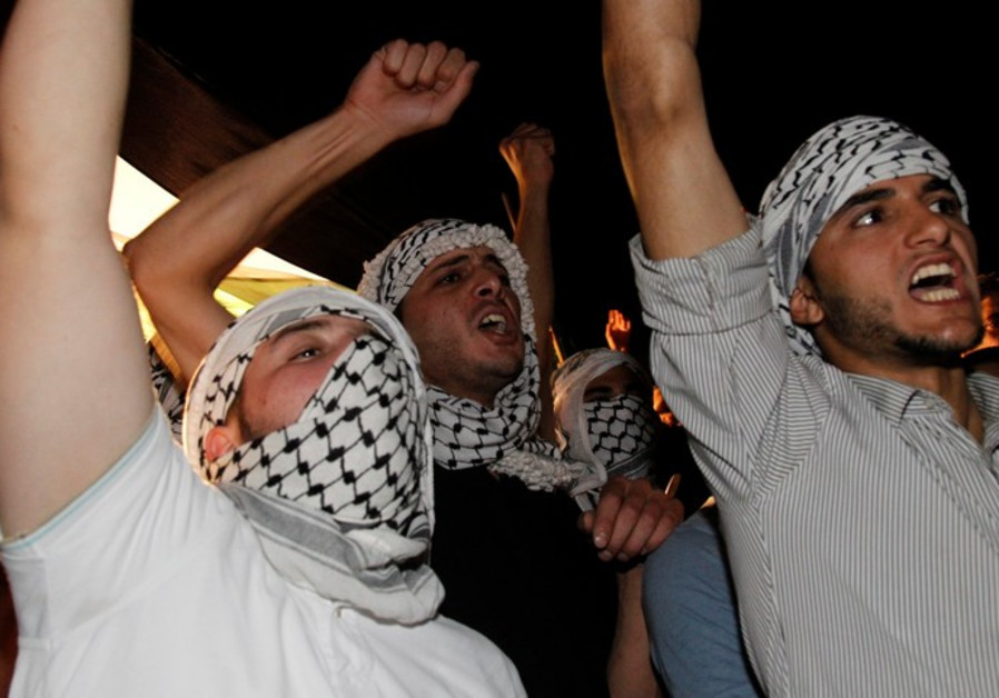 Protesters shout anti-Israel slogans during a protest in Amman