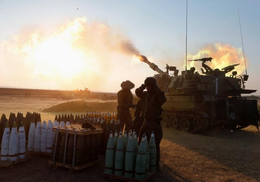 An Israeli mobile artillery unit fires towards the Gaza Strip July 21