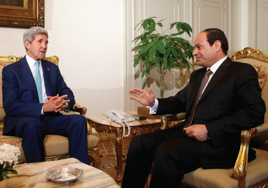 US SECRETARY of State John Kerry (left) meets with Egyptian President Abdel Fatah al-Sisi in Cairo