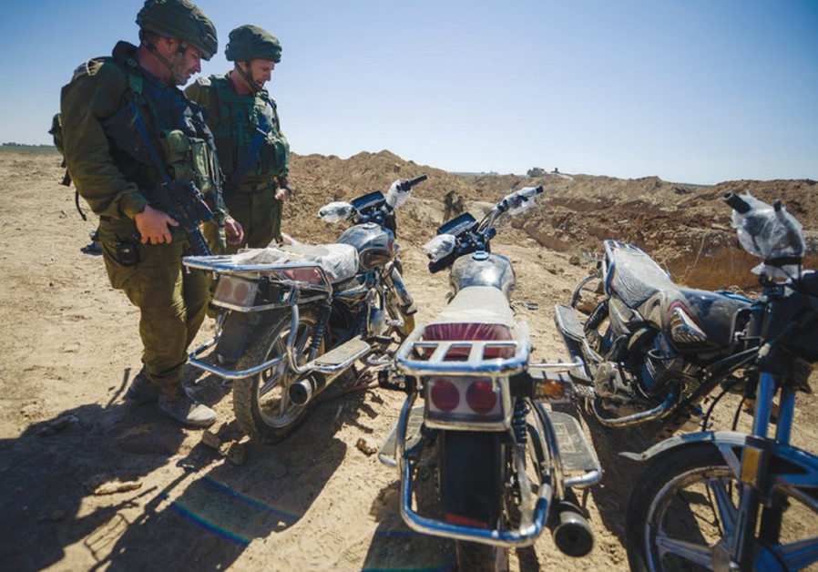 IDF soldiers discover Hamas motorcycles.