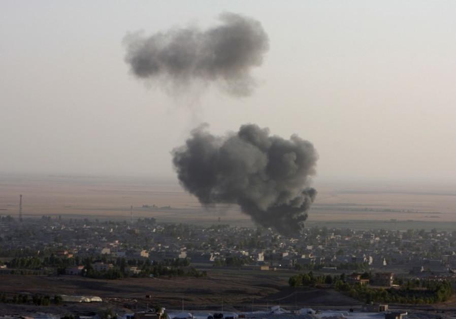 Smoke billows from the town of Makhmur during clashes between Iraqi Kurdish Peshmerga troops and Isl