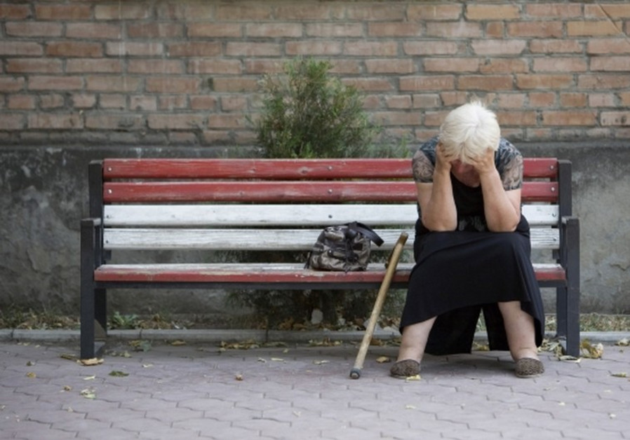 An elderly woman suffers from PTSD. [illustrative]