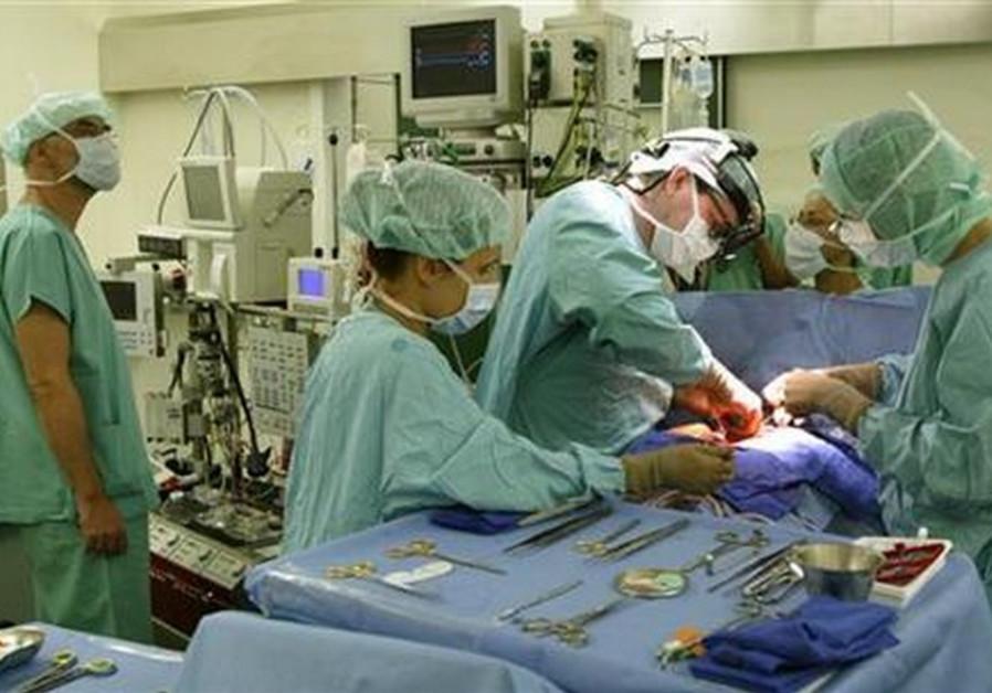 Doctors perform surgery [illustrative].