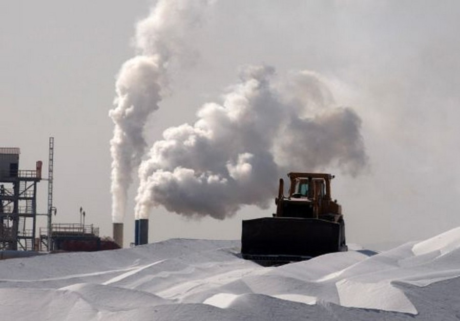 A bulldozer works at a magnesium factory near the Dead Sea.