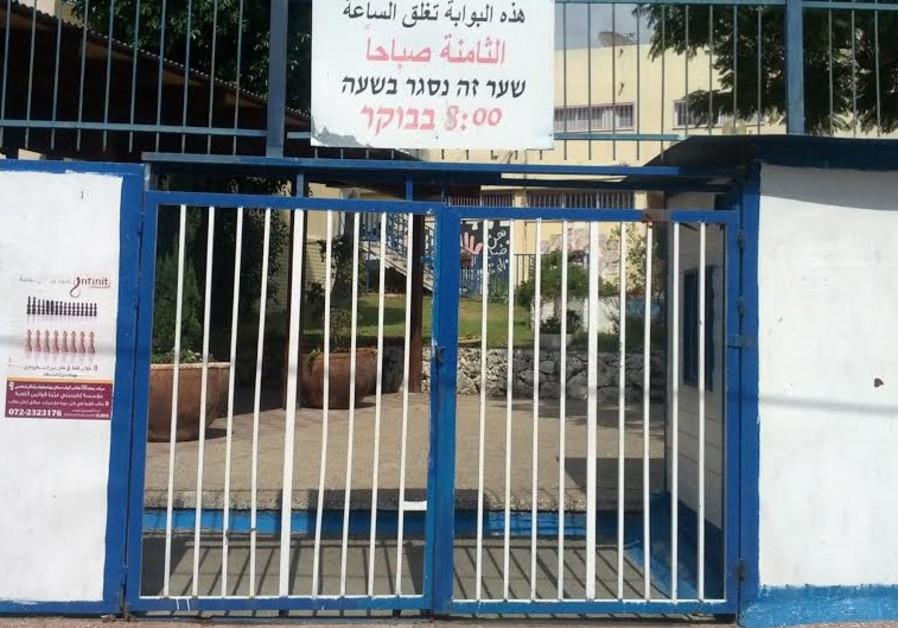 Closed school gate in Taibe