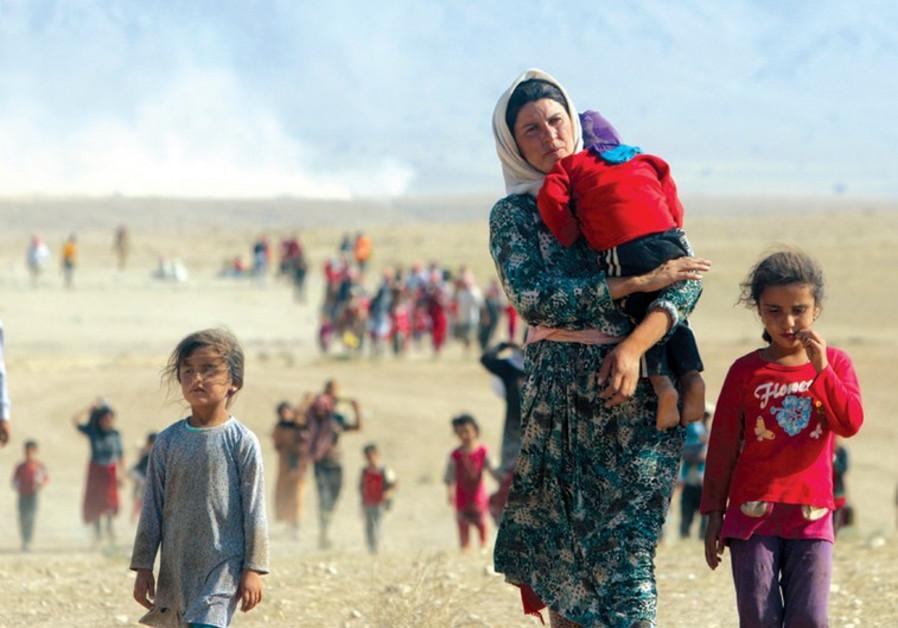 Yazidi refugees near the Syrian border