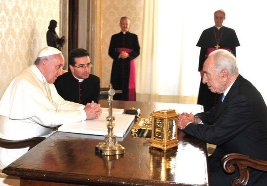 POPE FRANCIS and former president Shimon Peres chat at the Vatican yesterday.