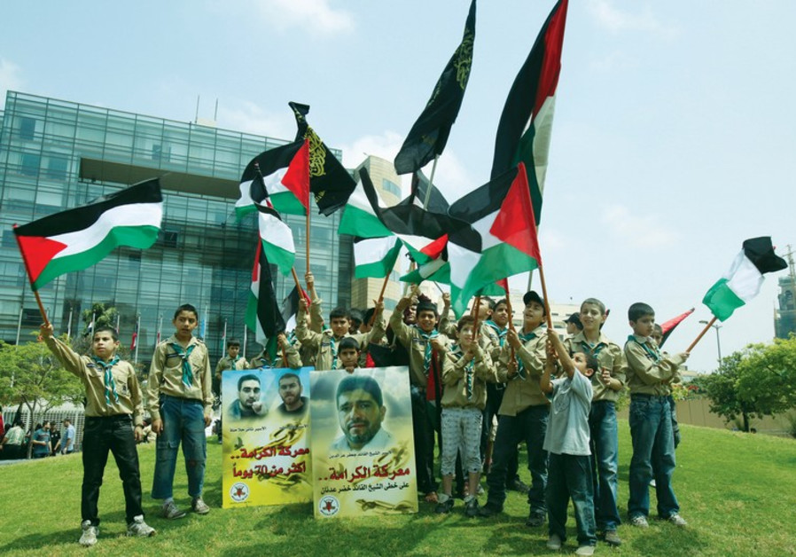 Palestinian youths with flags