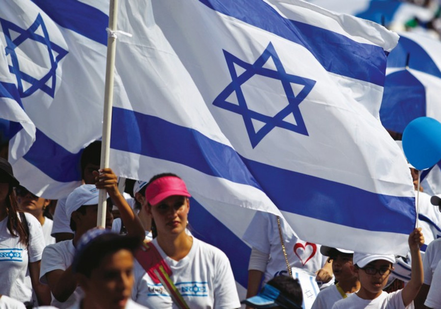 People carry Israeli flags during a Jerusalem Day march in the capital.