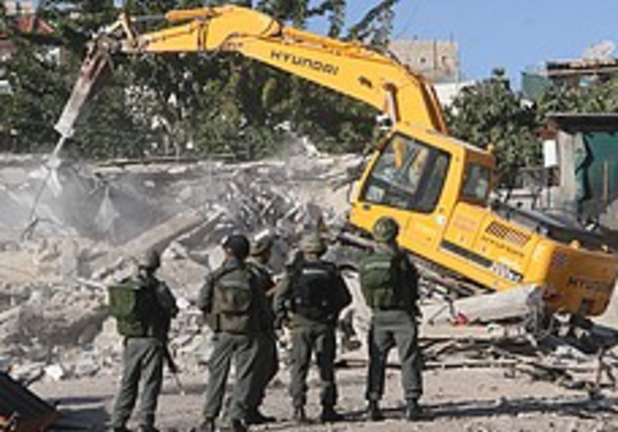 J'lem distributes building-code violation notices in Silwan