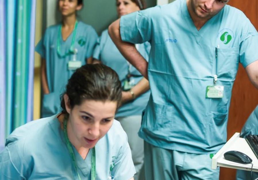 doctors oversee patient
