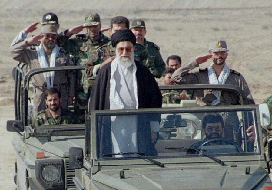 Iran's supreme leader, Ayatollah Ali Khamenei, stands in front of a jeep