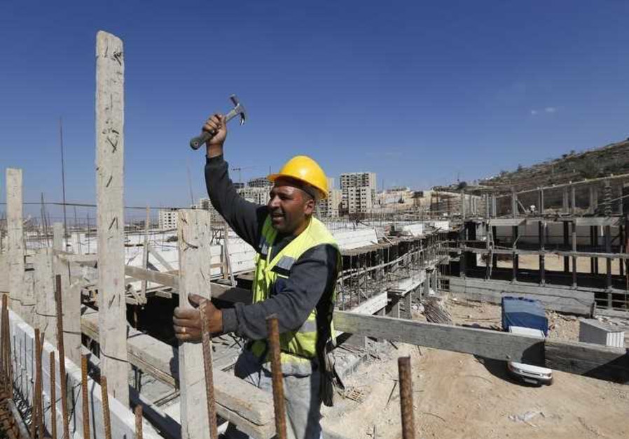 A Palestinian laborer works on a construction site in the new Palestinian town dubbed Rawabi