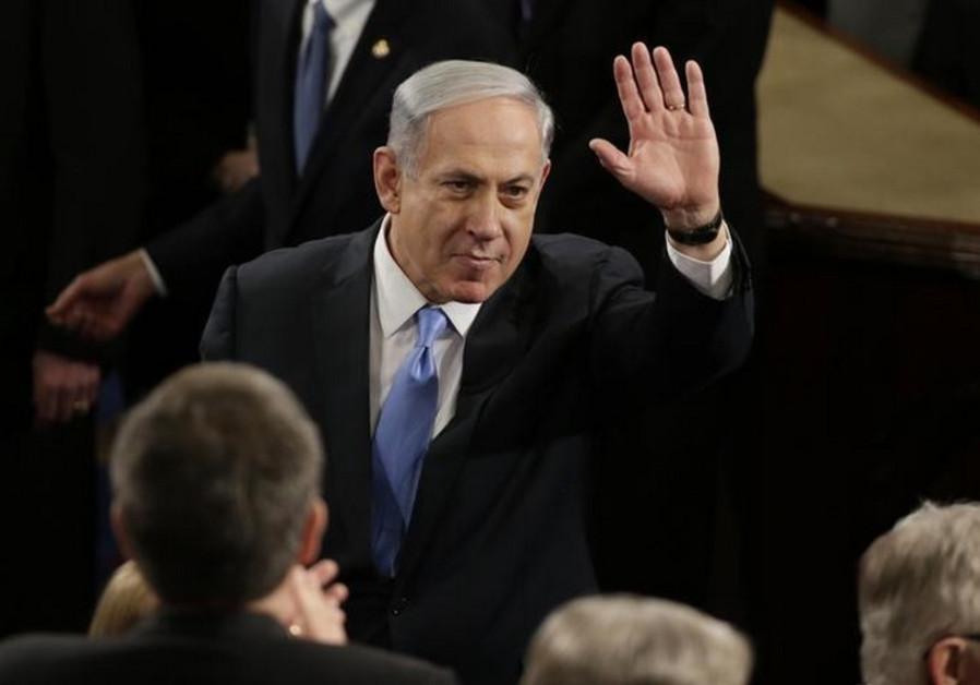 Prime Minister Benjamin Netanyahu gestures during his appearance before Congress