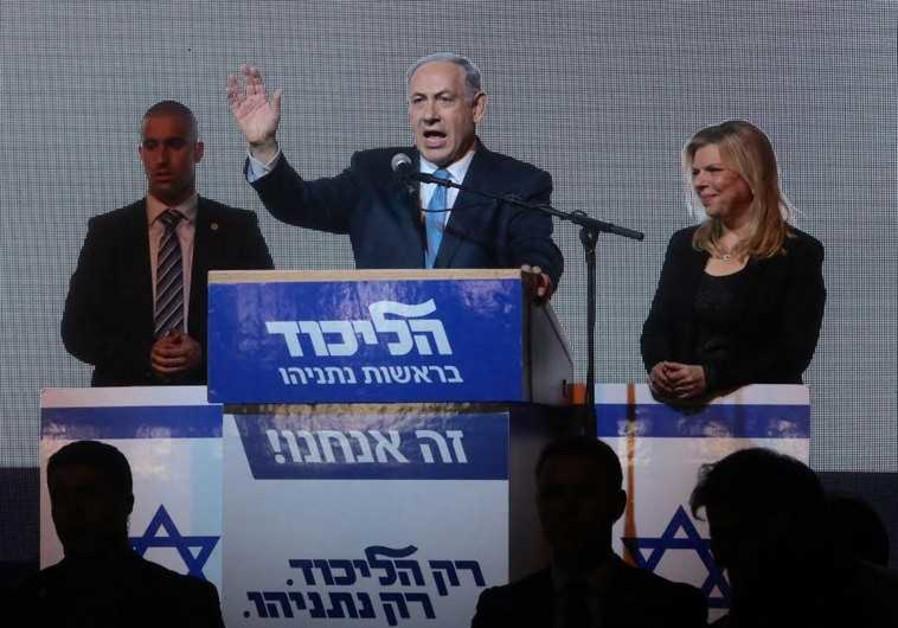 Prime Minister Benjamin Netanyahu gestures during his victory speech at Likud headquarters