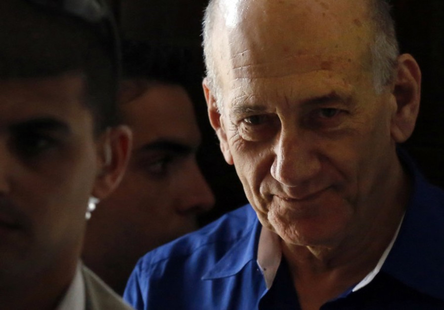 President Rivlin agrees to ease former PM Olmert's post prison restrictions