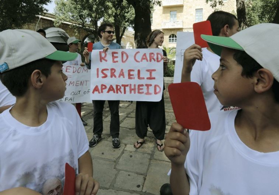 PALESTINIAN KIDS protest in favor of ejecting Israel from FIFA, the soccer federation, last month