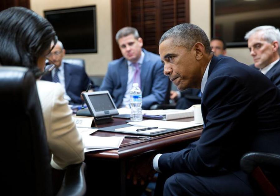 President Barack Obama listens to National Security Advisor Susan E. Rice
