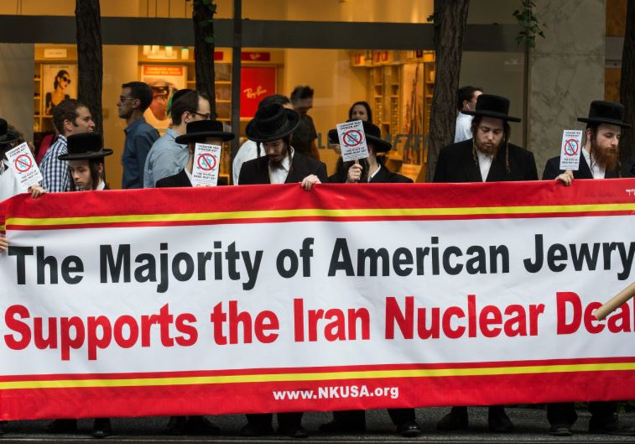 """Anti-Zionist Orthodox Jews throw a counter-protest across the street from a """"Stop Iran Rally"""""""