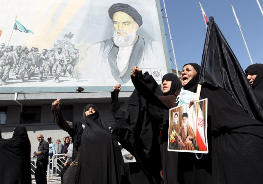 Iranian worshipers in Tehran chant slogans during a protest against Saudi Arabia