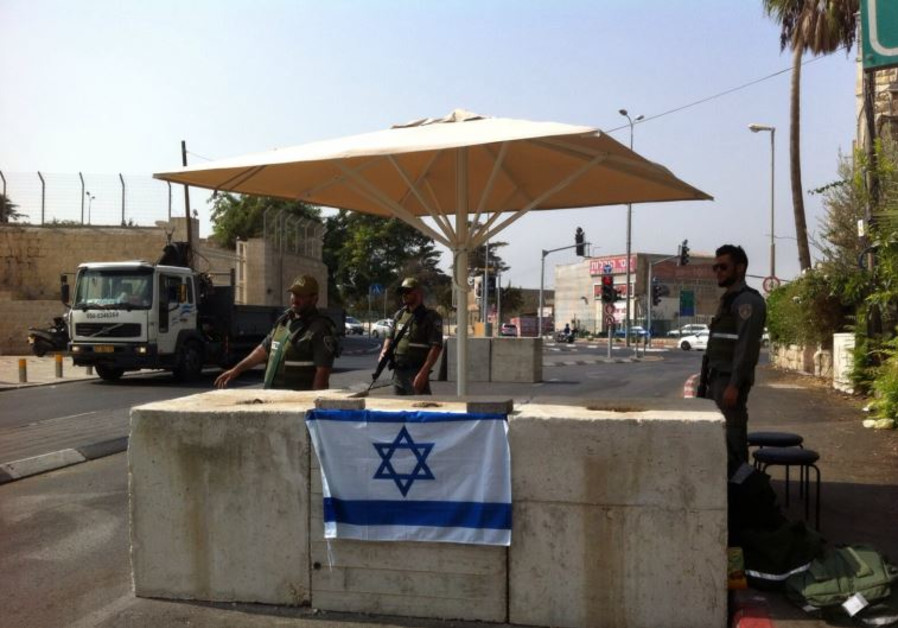 POLICE GUARD a checkpoint set up in Abu Tor on Monday