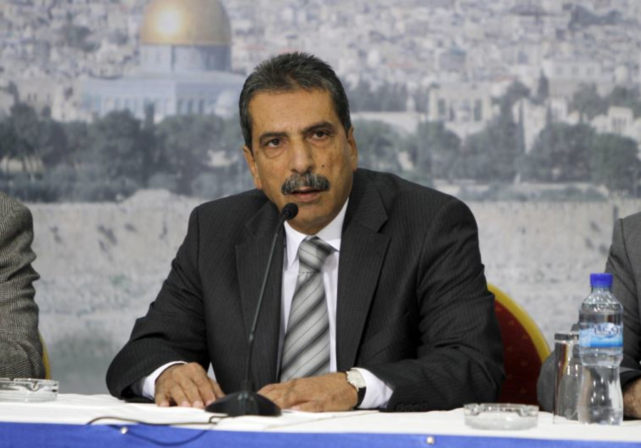 Tawfiq Tirawi speaks during a news conference in the West Bank city of Ramallah