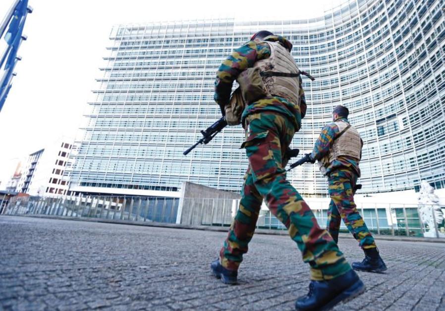 BELGIAN SOLDIERS patrol outside European Commission headquarters in Brussels