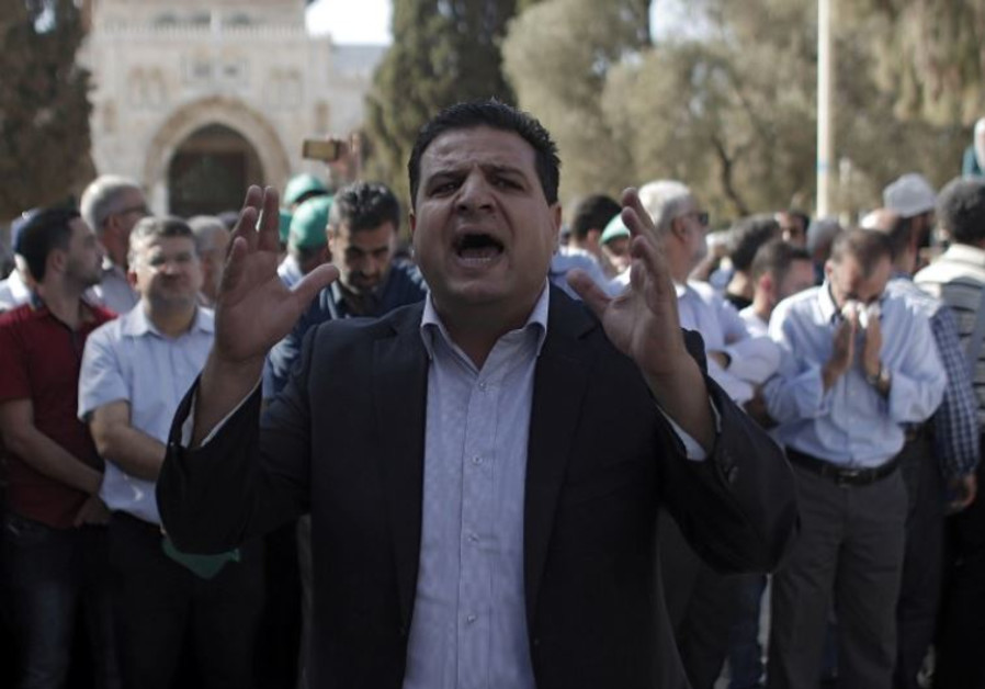 Joint List head Ayman Odeh shouts slogans near the Dome of the Rock in Jerusalem
