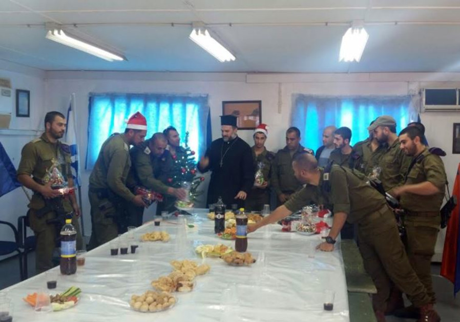 Father Naddaf of Nazareth with Christian Israeli IDF soldiers at a Christmas party on December 21, 2