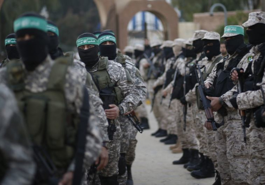 Palestinian Hamas militants take part in a rally in memory of their seven comrades