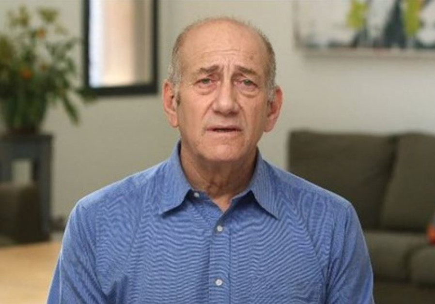 Ehud Olmert tapes a statement prior to his entering prison