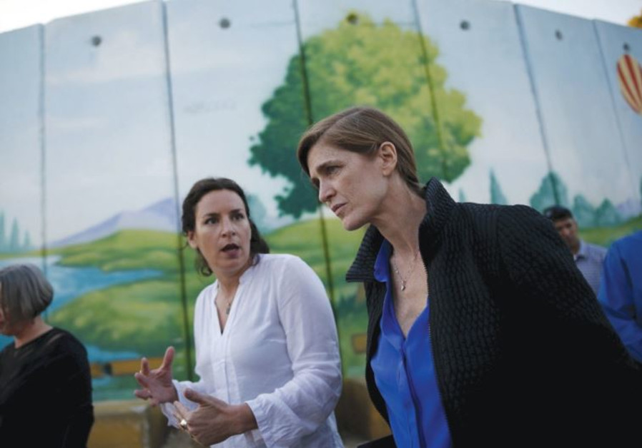 SAMANTHA POWER, the US ambassador to the UN, speaks with a local resident yesterday.