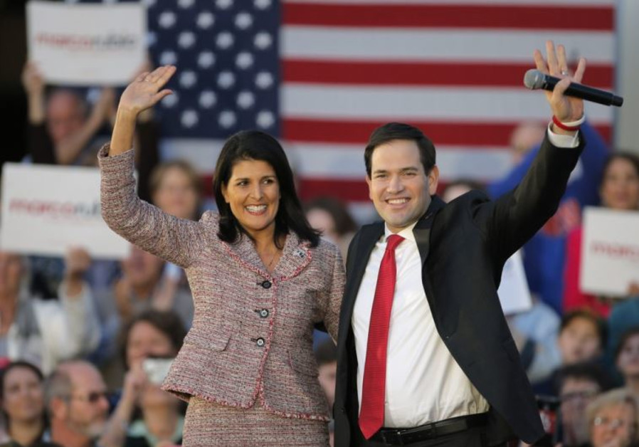 South Carolina Governor Nikki Haley and Marco Rubio react on stage during a campaign event in Chapin