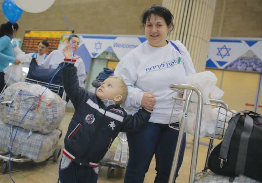 A UKRAINIAN boy grabs a balloon that is decorating the arrivals area of Ben-Gurion Airport.