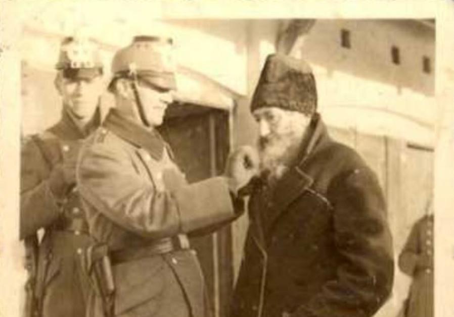 Nazi cutting beard of elderly Jew