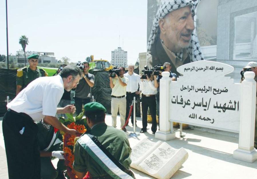 SINN FEIN LEADER Gerry Adams lays a wreath at the grave of Yasser Arafat in Ramallah in 2006