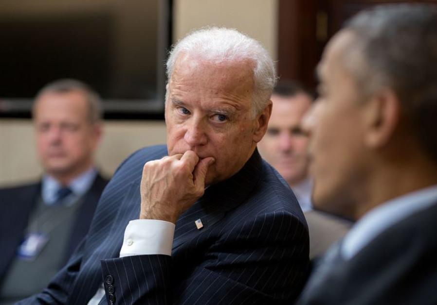 Vice President Joe Biden listens to President Barack Obama in the White House