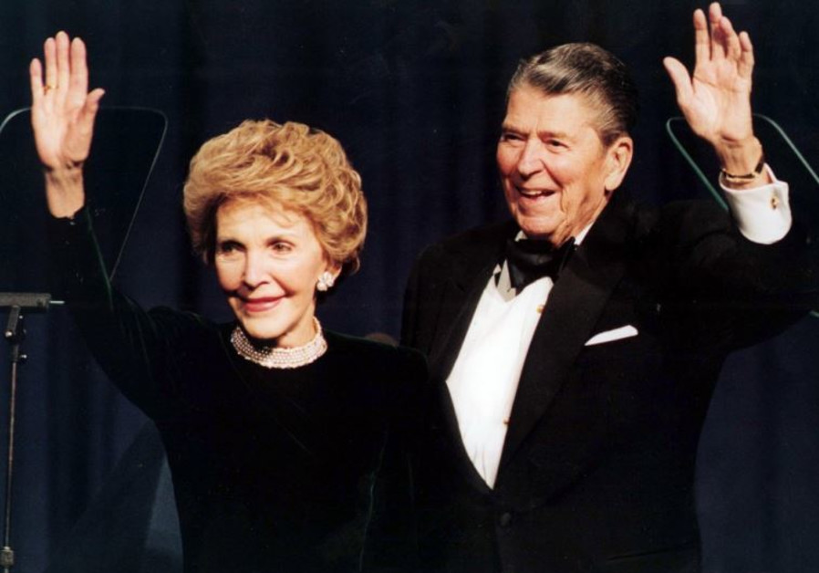 President Ronald Reagan and his wife Nancy wave while attending a gala celebrating his 83rd birthday