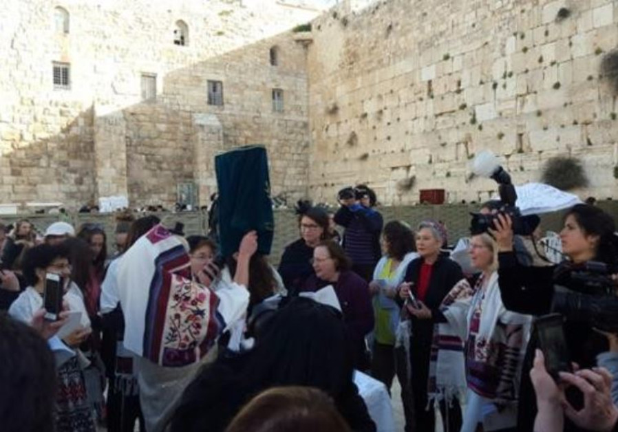 Women of the Wall with Torah scroll in women's section of the Western Wall, March 11, 2016