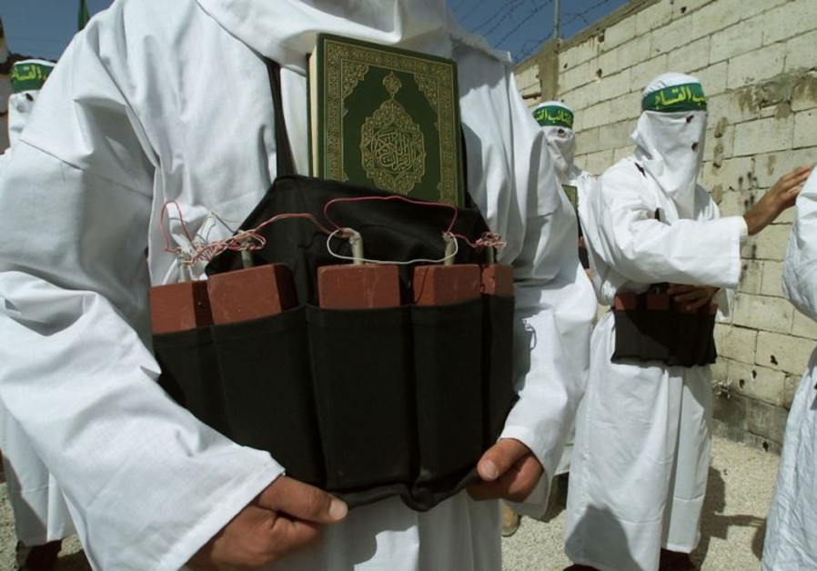 A Palestinian from the Islamic group Hamas wears a belt of simulated explosives